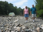 Lisa and Gary Alexander walking the path their house took when it was washed away by Tropical Storm Irene. The