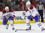 Montreal Canadiens' Rene Bourque (27) loses his stick as Tomas Plekanec (14), of the Czech Republic, chases the puck during the second period of an NHL hockey game in Raleigh, N.C., in April.