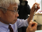Health Commissioner Dr. Harry Chen draws a whooping cough vaccine on Wednesday in Barre.