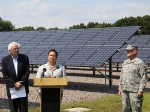 Sen. Bernie Sanders, EPA Administrator Lisa Jackson and Vermont Air Guard General Tom Drew stand in front of a 1.45-megawatt solar energy installation at the Vermont Air Guard Base in South Burlington Thursday.