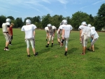 Hanover High School Football Team begins practice following passage of new law governing response to possible concussion during play.