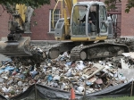 An excavator moves a mountain of debris from Tropical Storm Irene outside the state office buildings in Waterbury. Vermont lawmakers are expected to get an update on how much the state can expect in federal help for cleaning up from Tropical Storm Irene.