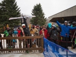 Skiers and snowboarders line up at the gondola on Monday.