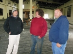 Paul Gallo, Greg Cox and David O'Rourke check out the space that will hold Rutland's Winter Farmers' Market starting this weekend.