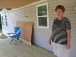 Weston resident Sandy Gaffney shows off her new porch.
