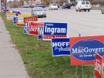 Political signs line the roadway, in an effort to get voters to the polls for today's election.