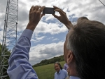 Gov. Peter Shumlin takes a photo of a new broadband tower installation in Plainfield in August.