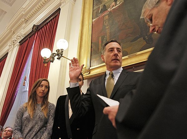Gov. Peter Shumlin takes the oath of office from Chief Justice John Reiber. Shumlin's daughters Rebecca and Olivia stand behind him.
