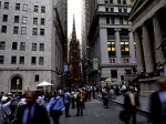 With Trinity Church in the background, people walk on Wall Street in 2008 in New York City