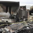 fire_at_philscotts_biz_toby_010912_ap12010915063.jpg