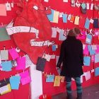 v_day_021413_a_visitor_reads_love_letters_posted_on_the_wall.jpg